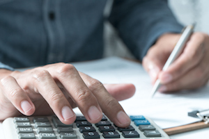 A Man Using a Calculator