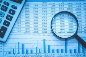 Spreadsheet Bank Accounts With Calculator and Magnifying Glass