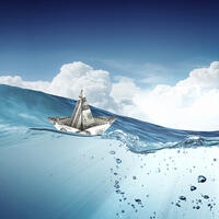 Ship made of dollar banknote floating in water-1