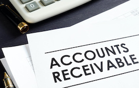 Documents About Accounts Receivable, Pen and Calculator